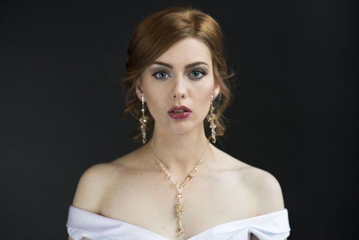 Biżuteria ślubna - komplet naszyjni i kolczyki - gronka z kryształów Swarovski - Golden Shadow