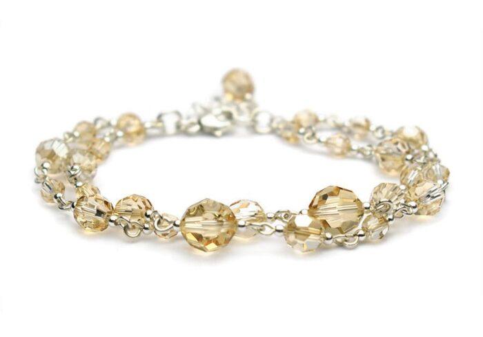 Złota bransoletka slubna - kryształki Swarovski