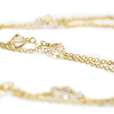 Złocony naszyjnik na plecy z kryształkami Swarovski Golden Shadow - Graceful Classic