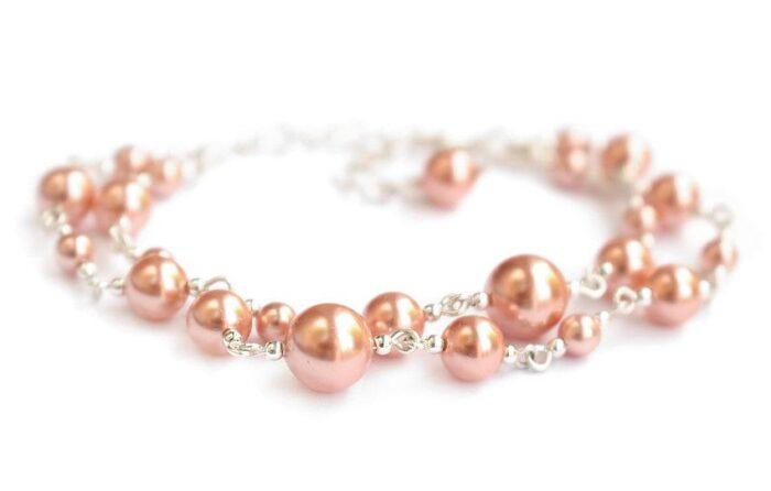 Bransoletka ślubna z perłami - brzoskwiniowo-różowe perełki Swarovski