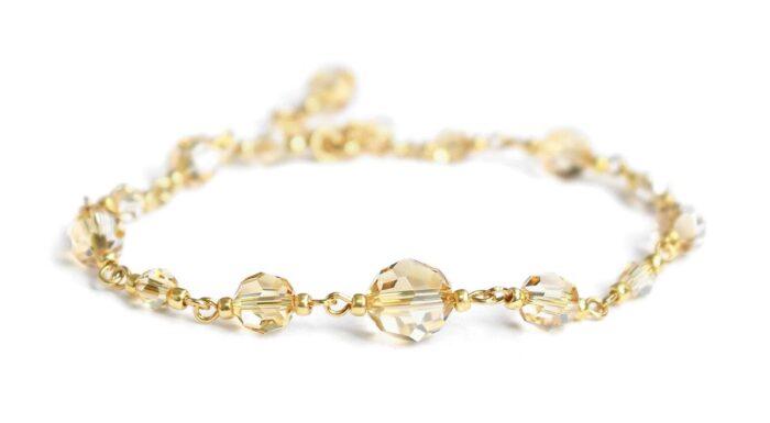 Delikatna złota bransoletka ślubna z kryształami Swarovski Golden Shadow - pozłacane srebro